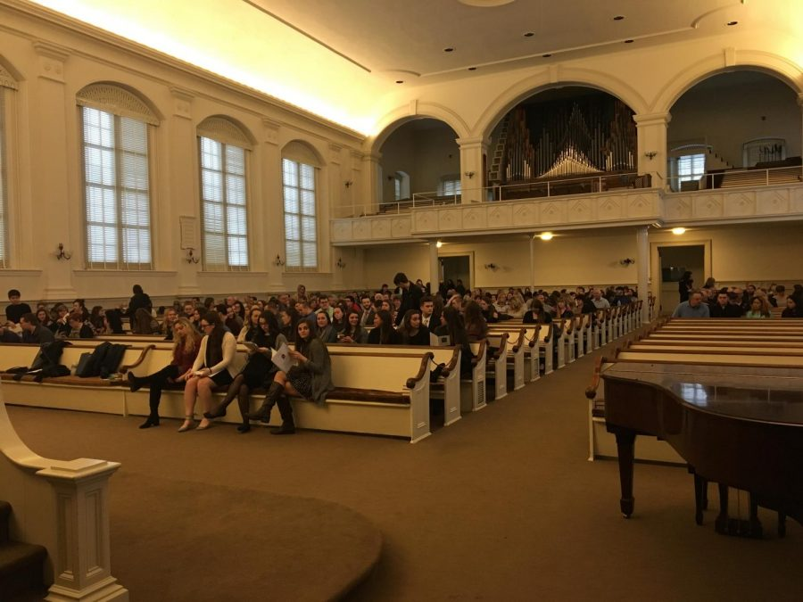 Photo+features+the+inside+of+Moravian+Church+with+large+oval+windows+and+the+pews+filled+with+nicely+dressed+college+students.