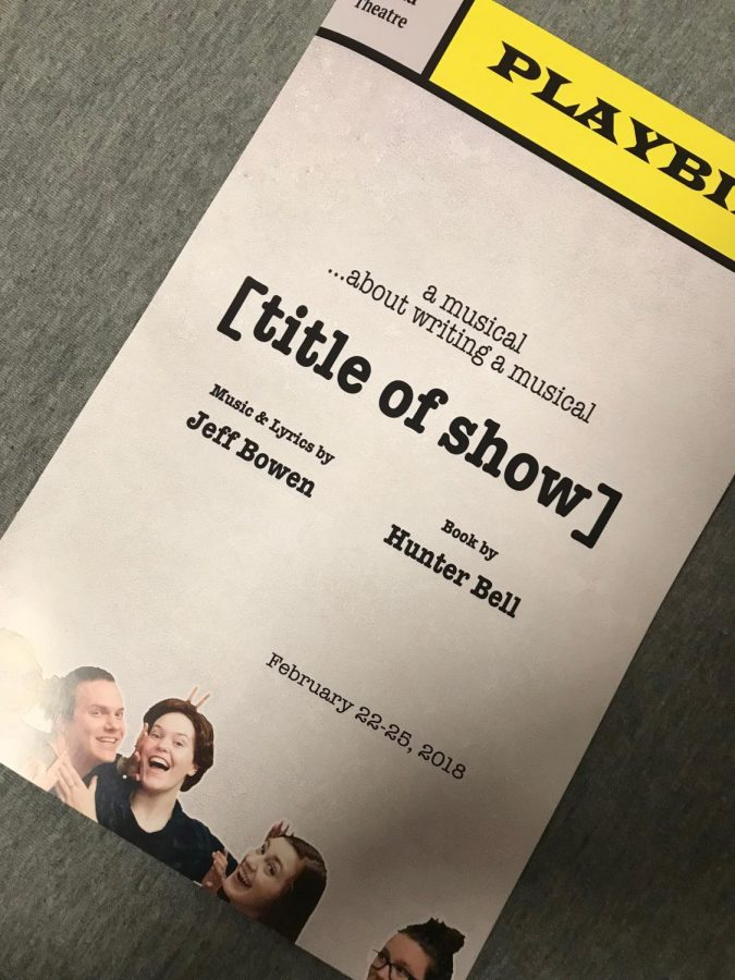 Picture features the [title of show] playbill with pictures of the cast with their arms around each other.