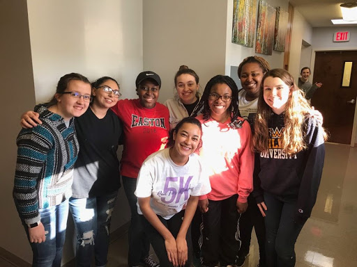 Moravian Staycationers from left to right: Haley Rogers, Miranda Shattah, Tolu Adebayo, Brooke Santy, Alejandra Lara, TahLea Wright, Nyeasha Bond, Christine Wieder, and Alexis Kersten at My Sister's Place in Washington, D.C.