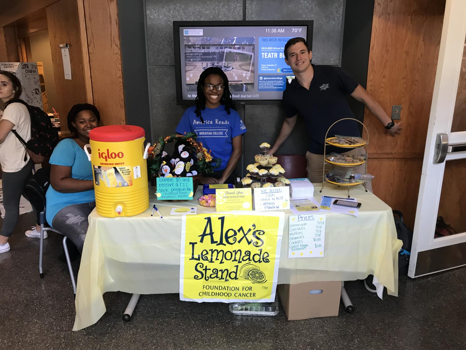Gamma Sigma Sigma members participating in a fundraiser for Alex's Lemonade Stand in the HUB.