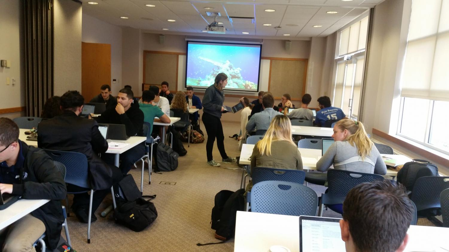 Students from a first-year writing seminar and the digital rhetorics class working in the United, Brethrens, & Church Rooms during the National Week on Writing. Credit: Gabrielle Stanley
