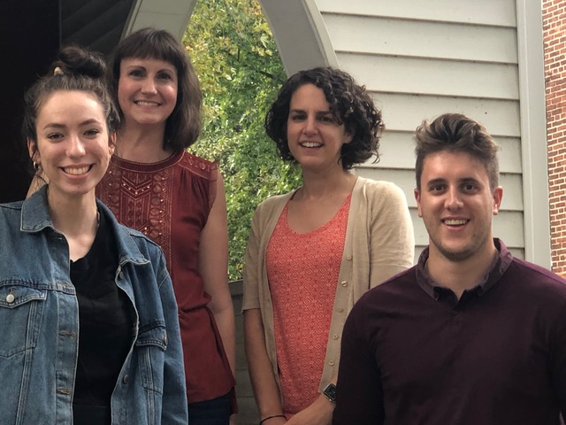 WAM Staff. Pictured (left to right) Gabrielle Stanley, Crystal Fodrey, Meg Mikovits, Christopher Hassay standing on the porch outside Zinzendorf Hall.