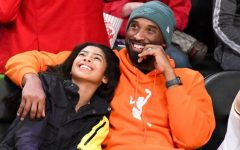 Kobe Bryant and daughter Gianna enjoying a basketball game