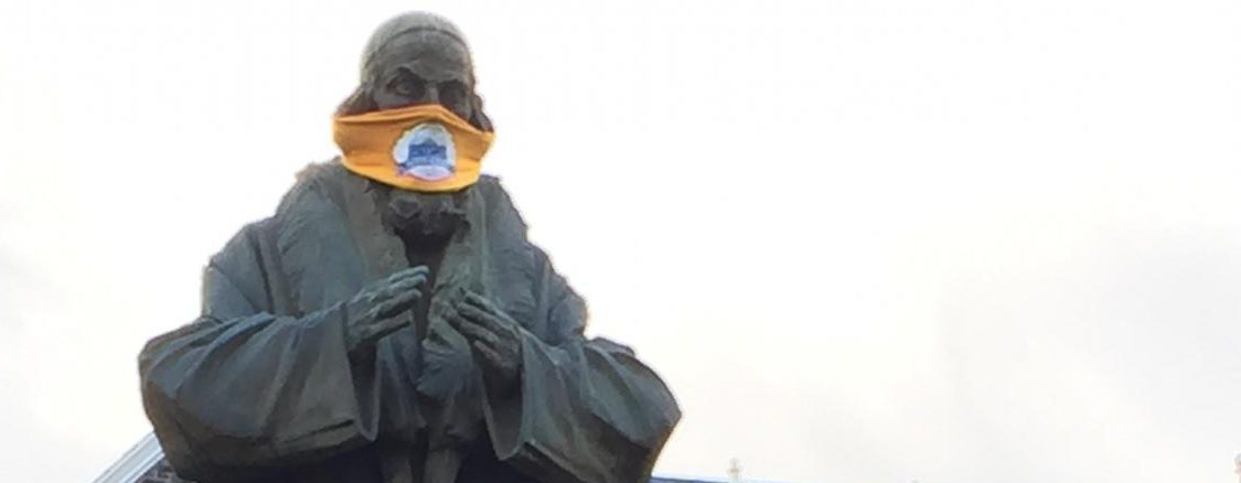 John Amos Comenius Statue sporting a mask to remind us to protect ourselves and others. Photo by: Mark Harris