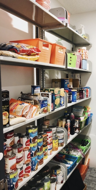 The shelves are stocked full with self-sustaining items in Mo's Cupboard in the Student Life Office of the HUB.