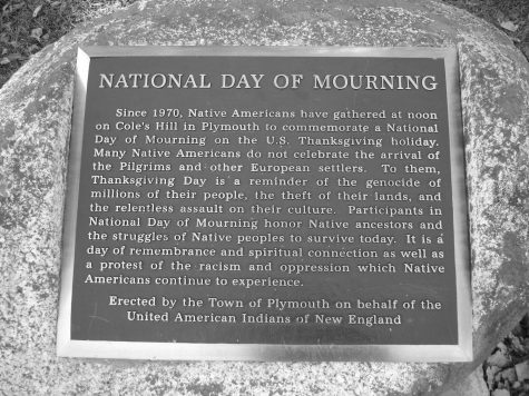 The plaque located in Plymouth that acknowledges the difficult relationship between indigenous people and Thanksgiving; Photo Courtesy of: capeandislands.org