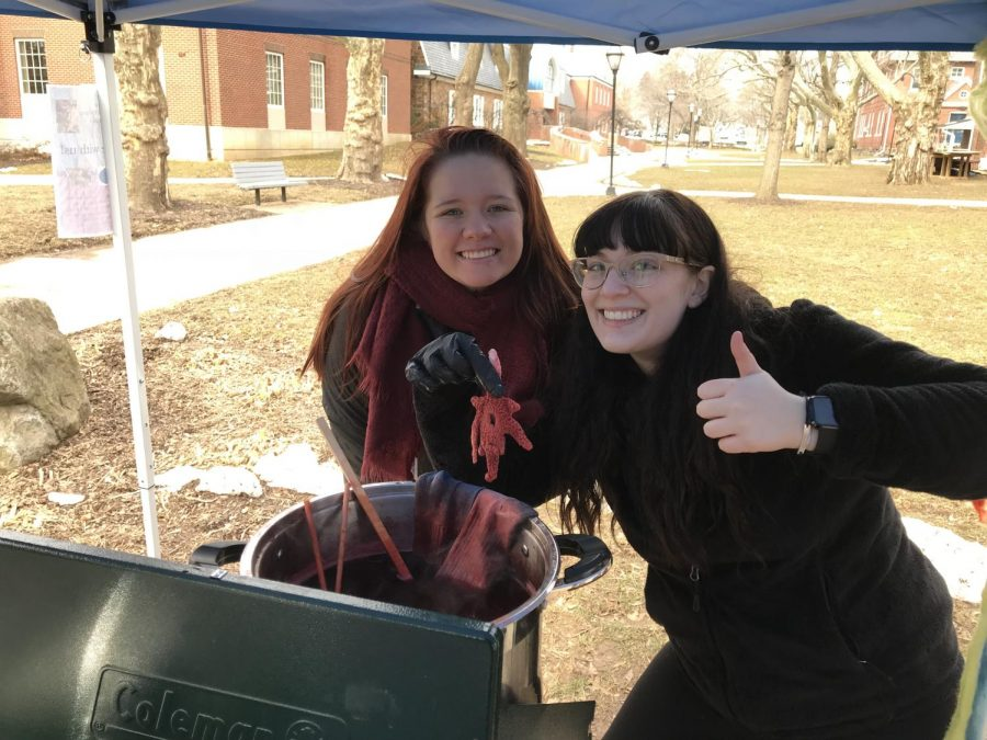 Two archeology students with a madder-dyed Moravian Star fresh out of the pot.