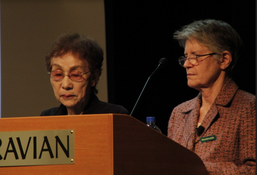 Okada telling her moving story alongside of translator Elizabeth Baldwin.