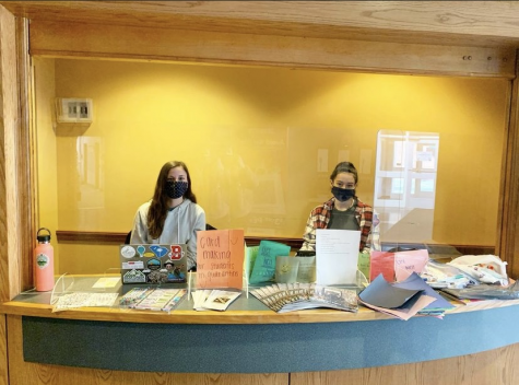 Natalie Stabilito and Nadia Belverio, Class of '22, volunteering at card making for students in quarantine at the HUB Kiosk. Photo courtesy of Mikayla Dennis.