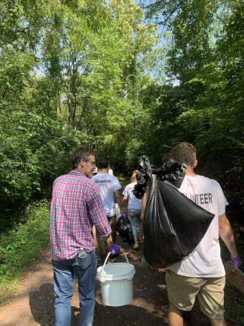 Picking up trash along the Monocacy Creek.